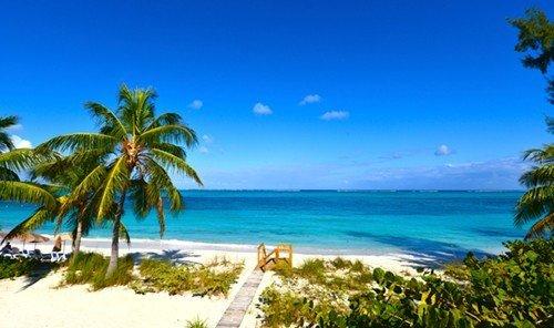Trip Ideas water sky tree outdoor palm Ocean Beach caribbean shore Coast Nature vacation Sea bay arecales tropics Resort Lagoon Island plant islet overlooking beautiful sandy
