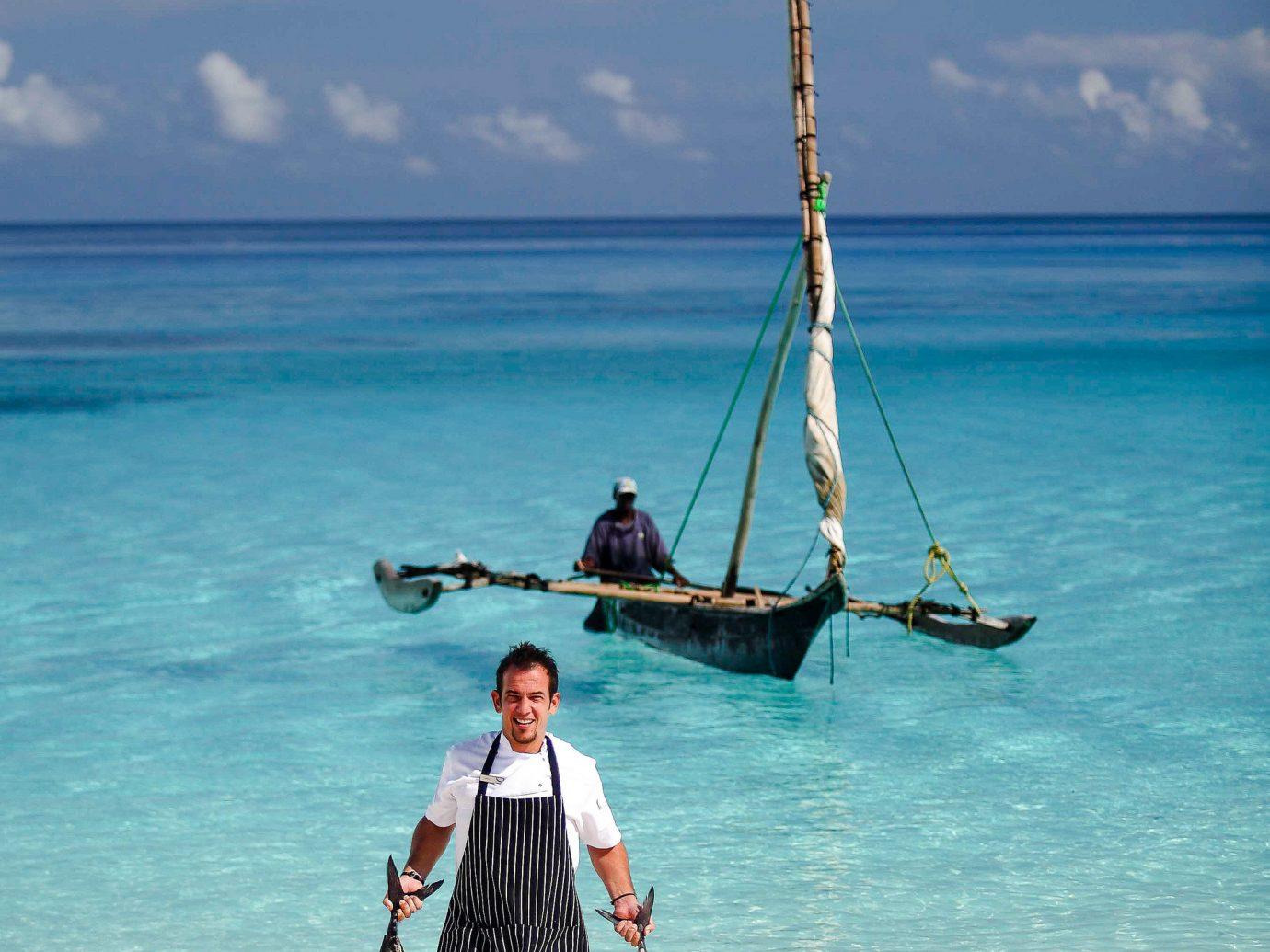 man bringing back fish from the ocean