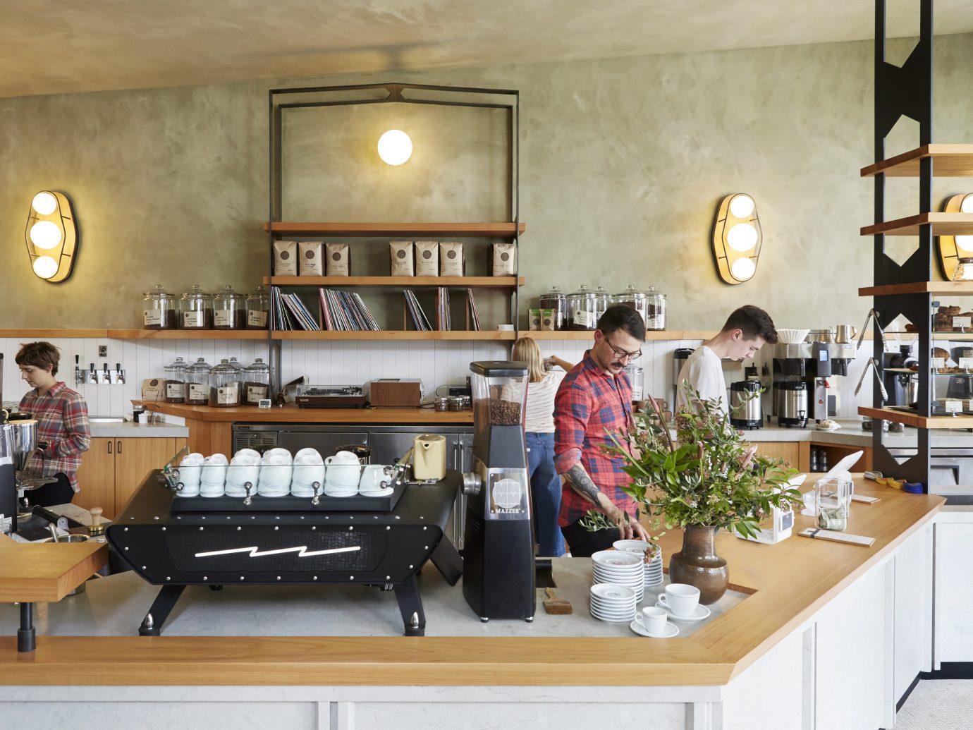 Food + Drink Offbeat Travel Trends indoor wall interior design café coffeehouse food restaurant furniture brunch table Island