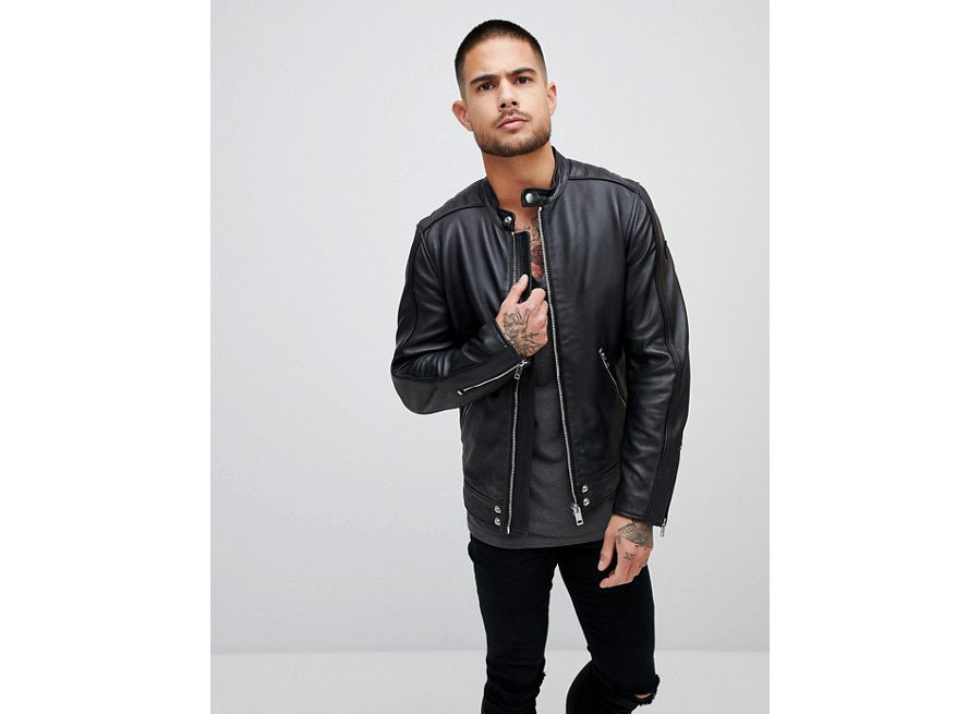 Packing Tips Style + Design Travel Shop person standing posing jacket leather jacket suit leather wearing textile material dressed