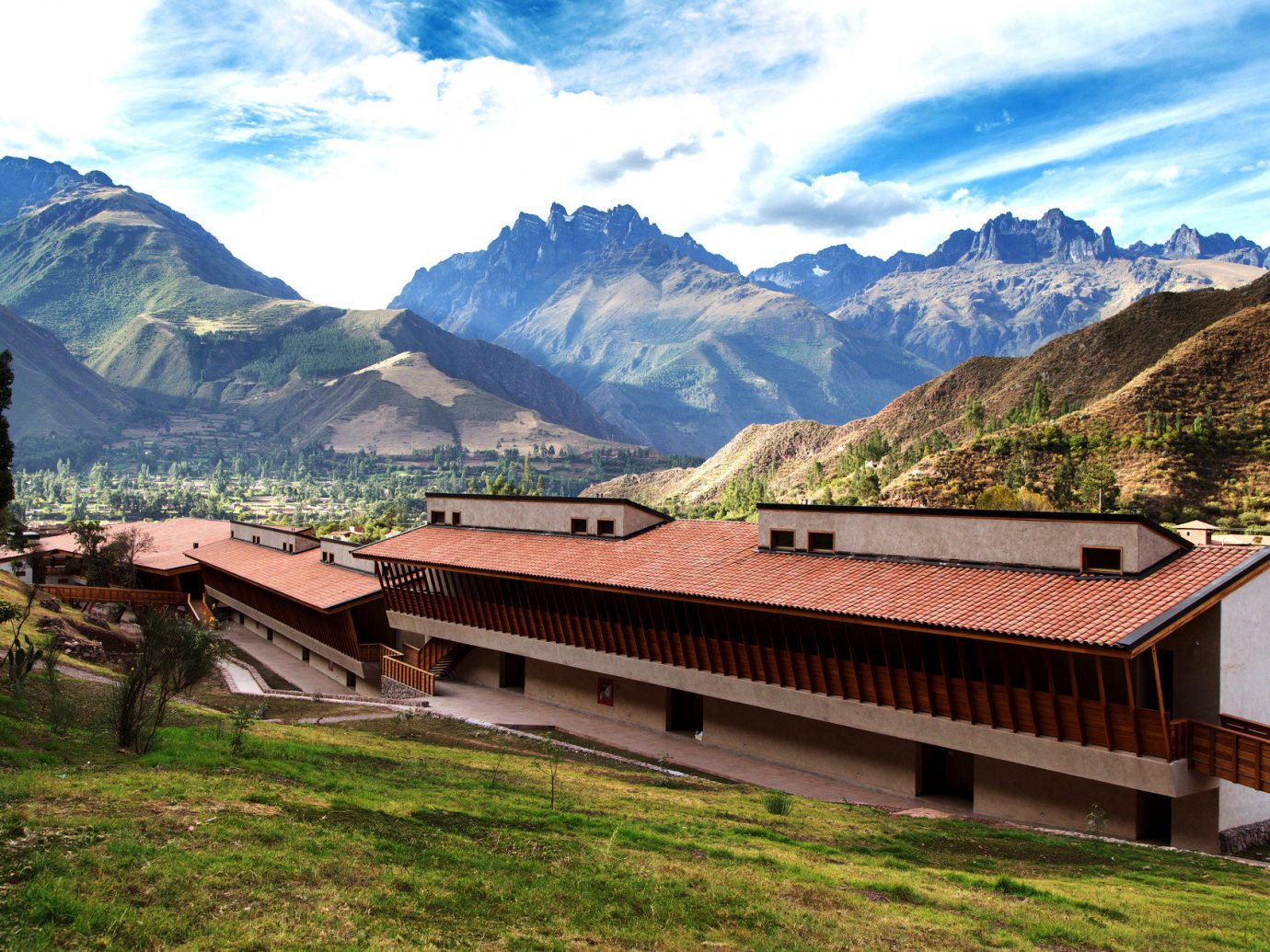 Exterior Hotels isolation Mountains Nature Outdoors remote Rustic mountain grass sky outdoor mountainous landforms mountain range geographical feature alps valley hill background rural area landscape Village estate mountain pass plateau area base hillside lush highland