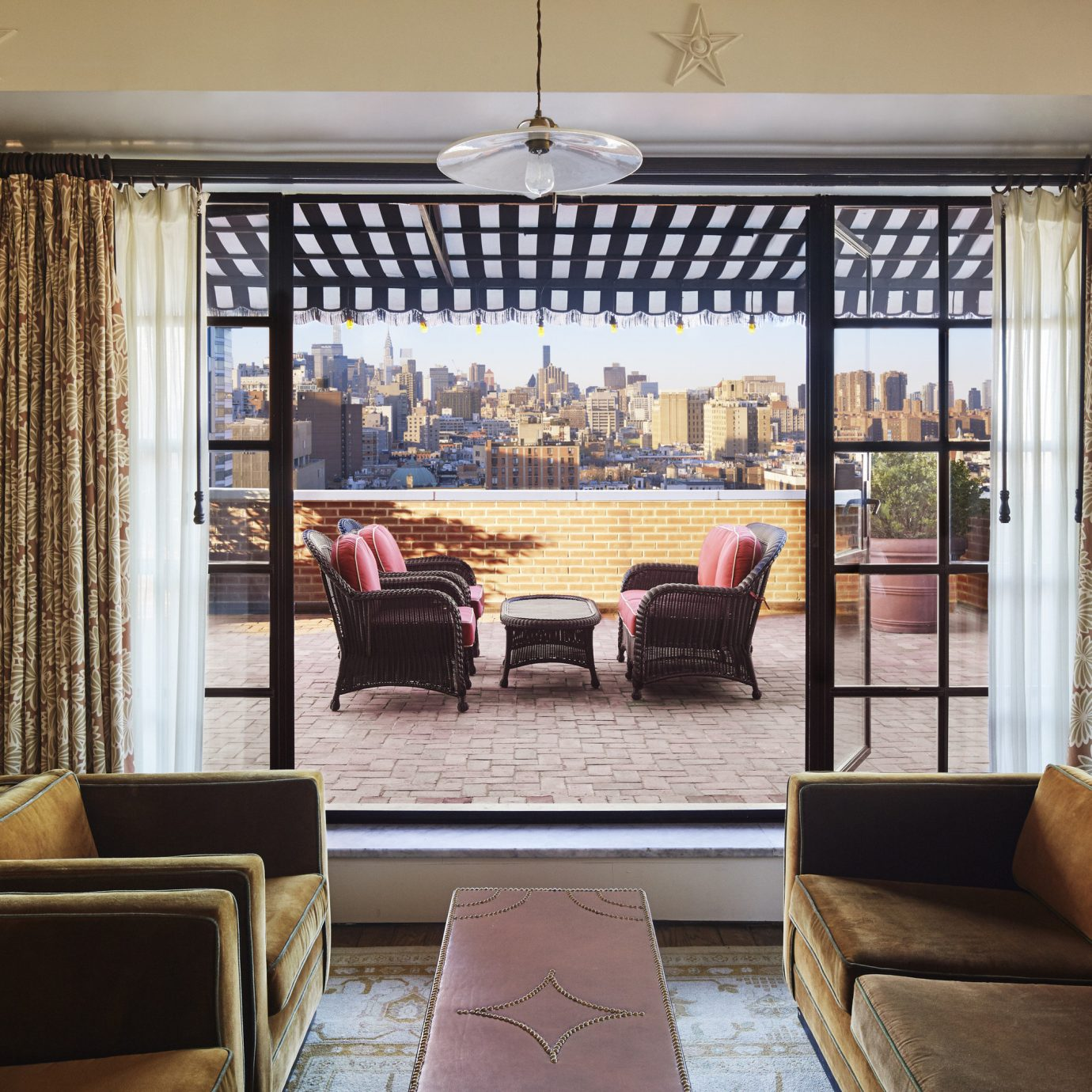 Celebs Hotels Trip Ideas sofa indoor Living room window floor chair interior design living room ceiling window treatment window covering furniture real estate Suite curtain home apartment seat Lobby decorated leather