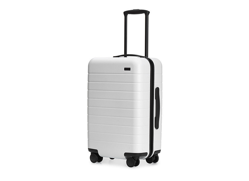 Health + Wellness Packing Tips Style + Design Travel Shop Travel Tips white suitcase product product design luggage & bags hand luggage kitchen appliance