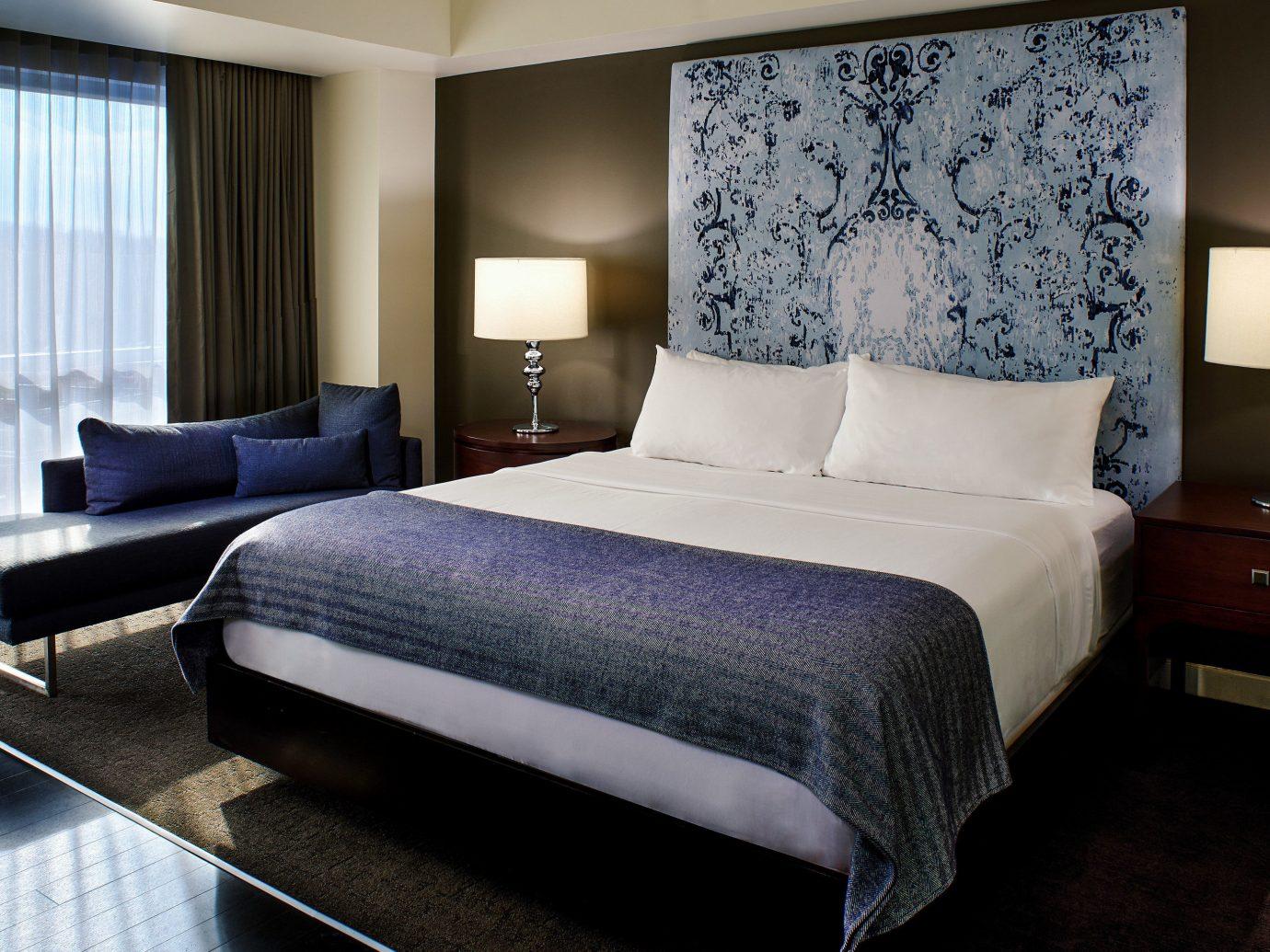 Budget Weekend Getaways bed indoor floor wall hotel Bedroom room window Suite interior design bed sheet night