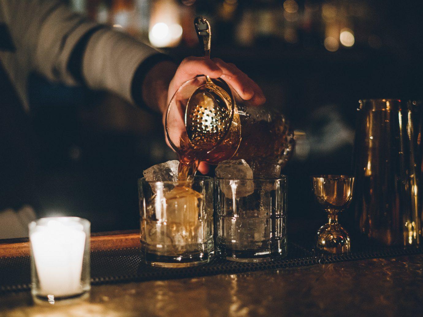 Jetsetter Guides light night Drink darkness distilled beverage lighting liqueur Bar glass