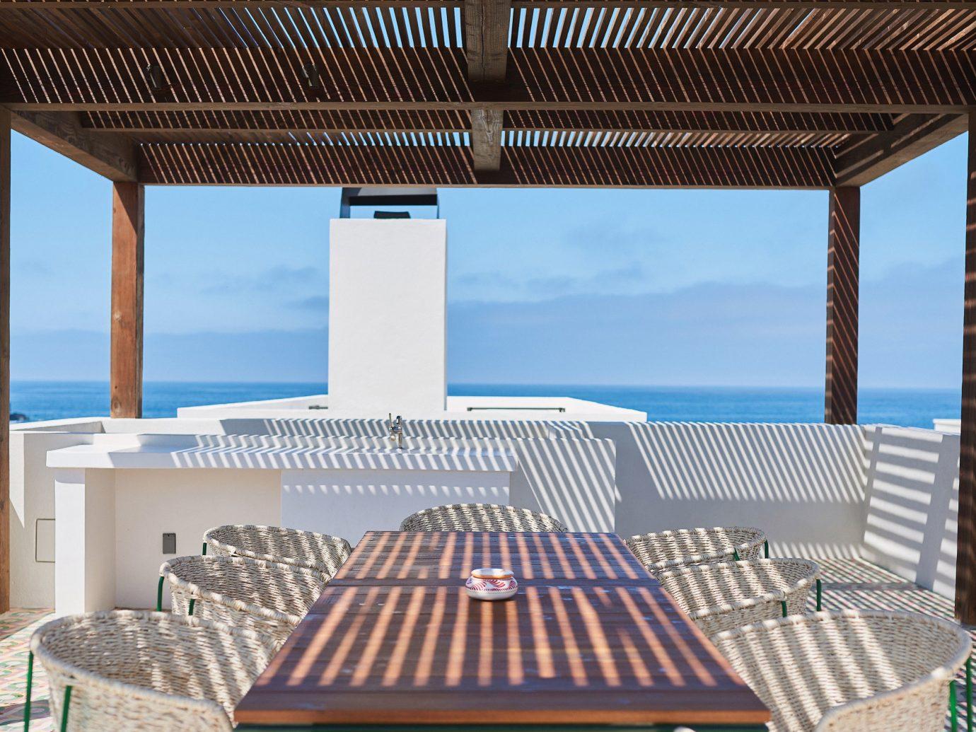 Trip Ideas chair property Resort swimming pool estate outdoor structure Villa interior design yacht Deck furniture