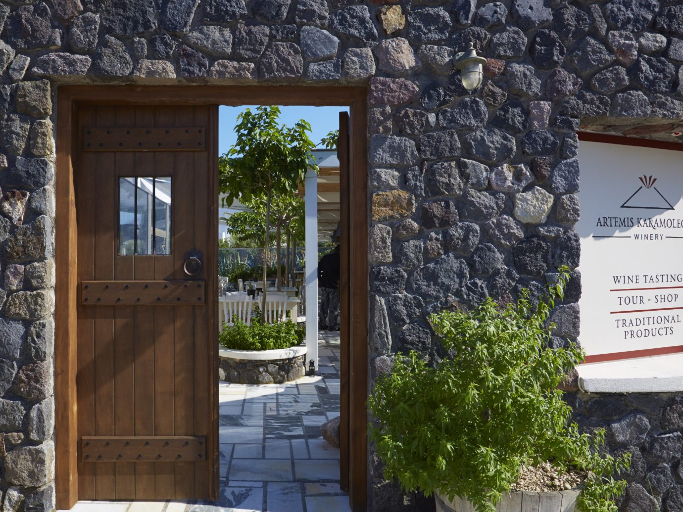 Trip Ideas building stone outdoor brick rock wall house home window facade door stone wall real estate tree cottage old