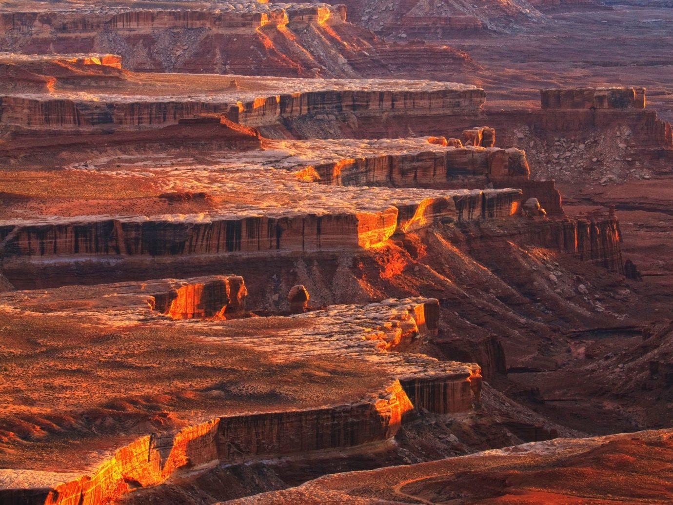 Health + Wellness Outdoors + Adventure valley canyon Nature mountain geographical feature outdoor orange landform natural environment wilderness butte geological phenomenon landscape rock plateau sunrise badlands Sunset geology formation terrain