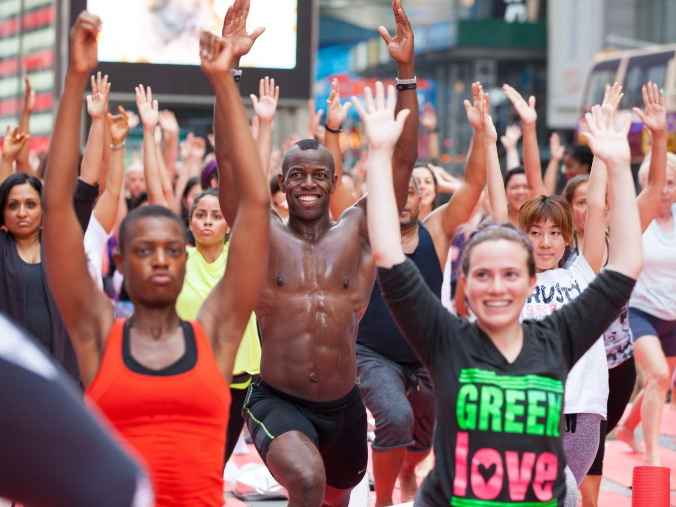 Festivals + Events Offbeat Trip Ideas Yoga Retreats person crowd cheering sports group endurance sports audience physical fitness endurance triathlon