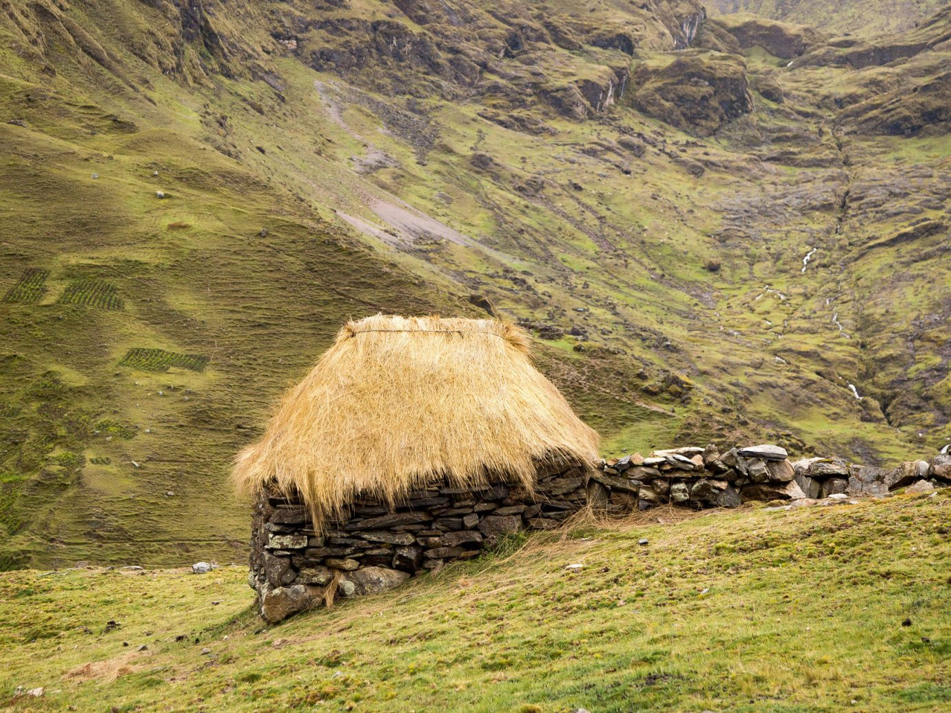 hills hut isolation Mountains Nature Outdoors remote rural serene thatched roof Travel Tips outdoor grass mountain rock agriculture field hill rural area plateau valley hillside hay geology grassy highland lush