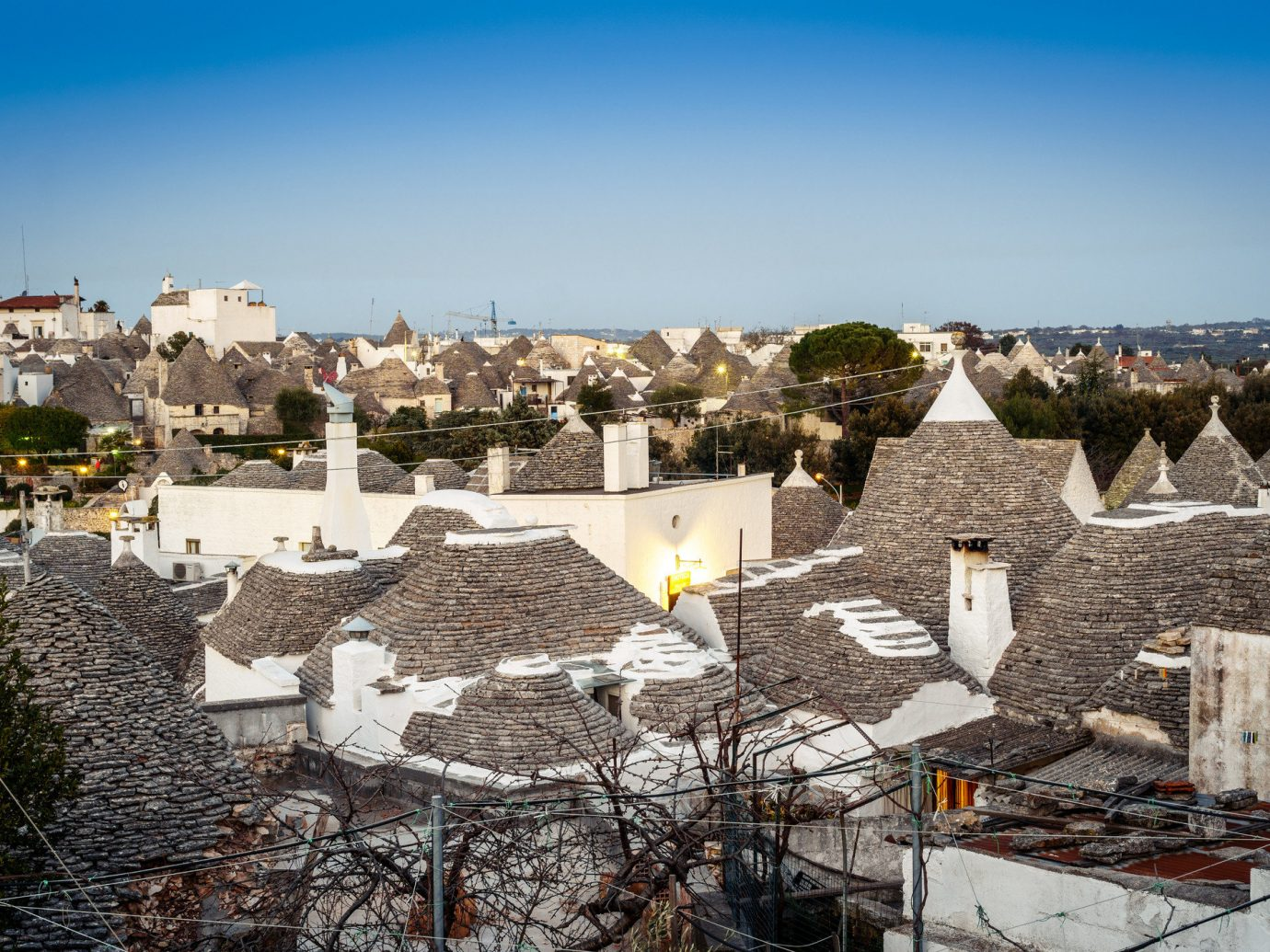 Trip Ideas sky outdoor snow Town urban area City wall roof Village tourism tree outdoor structure cityscape building house panorama