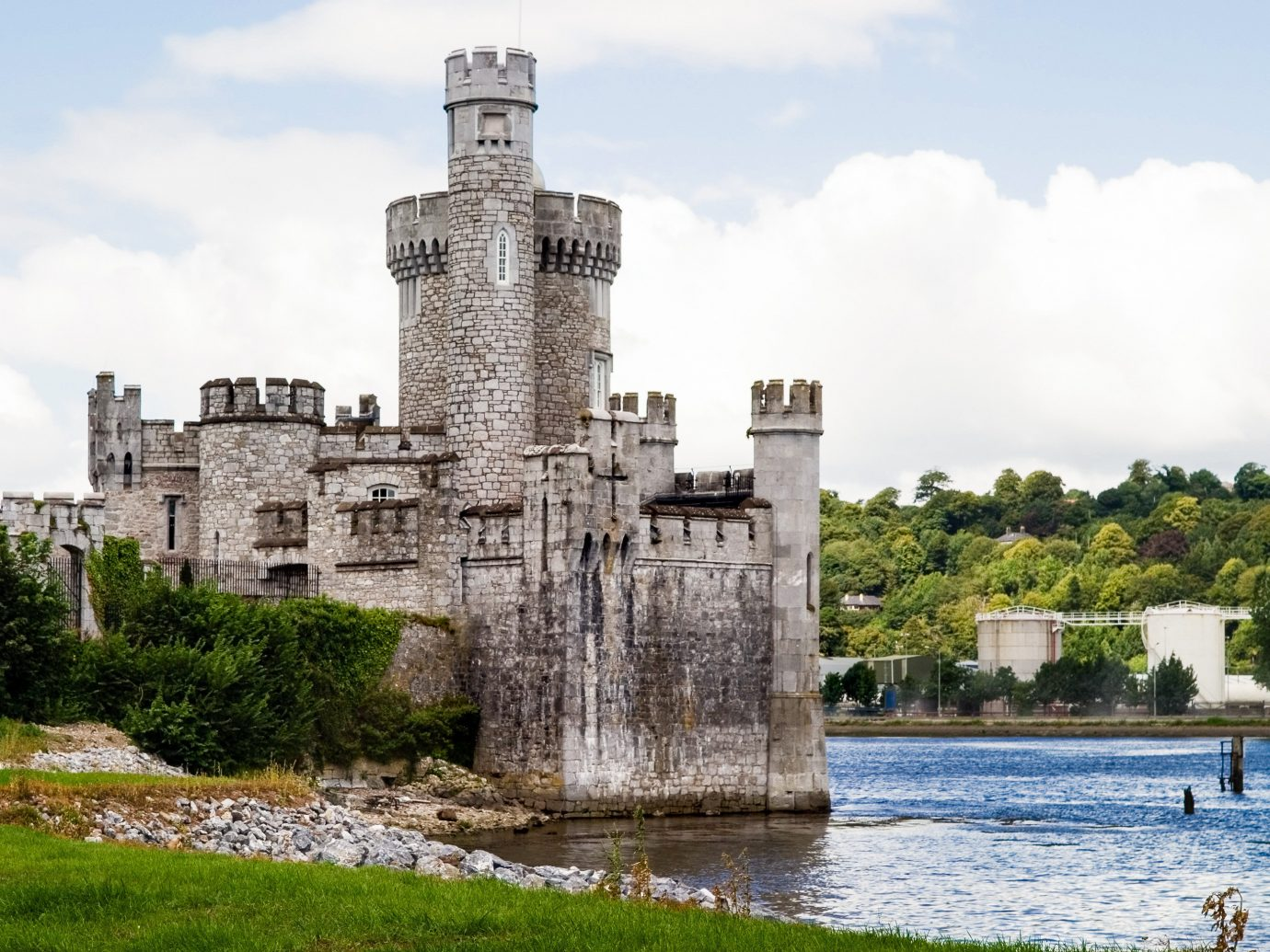 Offbeat sky building outdoor water grass castle moat River water castle fortification national trust for places of historic interest or natural beauty stately home medieval architecture tree château Lake reservoir estate tours old stone