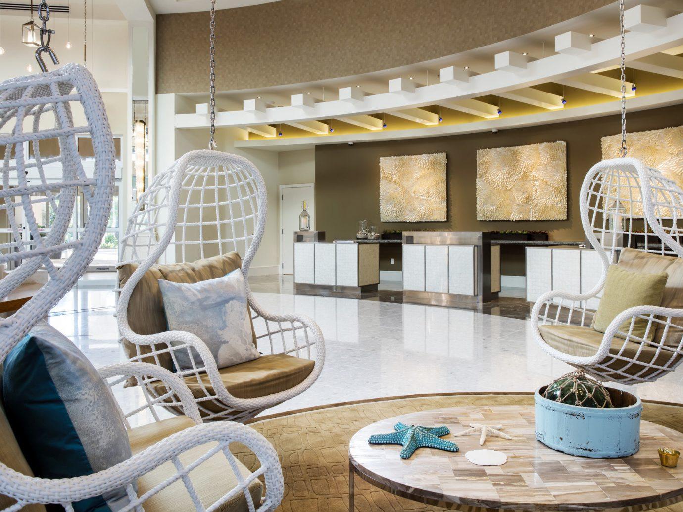 Hotels indoor chair room property dining room living room Lobby interior design home floor estate Design condominium dining table