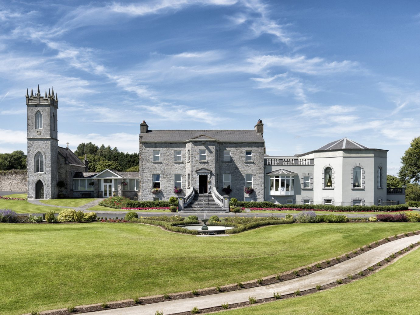 Dublin Ireland Trip Ideas grass sky outdoor house estate property mansion home stately home national trust for places of historic interest or natural beauty real estate building cottage manor house old cloud lawn landscape tree farmhouse grassy land lot stone