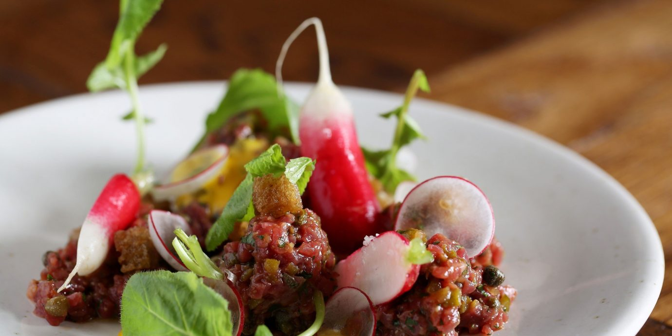 Food + Drink plate food table dish indoor meat salad produce cuisine meal vegetable meatball piece de resistance