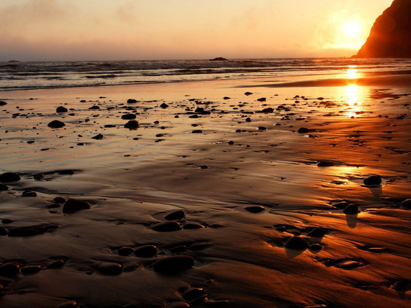 Trip Ideas outdoor sky Sunset Sun Beach reflection Nature shore Sea Coast horizon Ocean sunrise body of water dawn wave cloud morning rock evening sunlight sand dusk wind wave material sandy