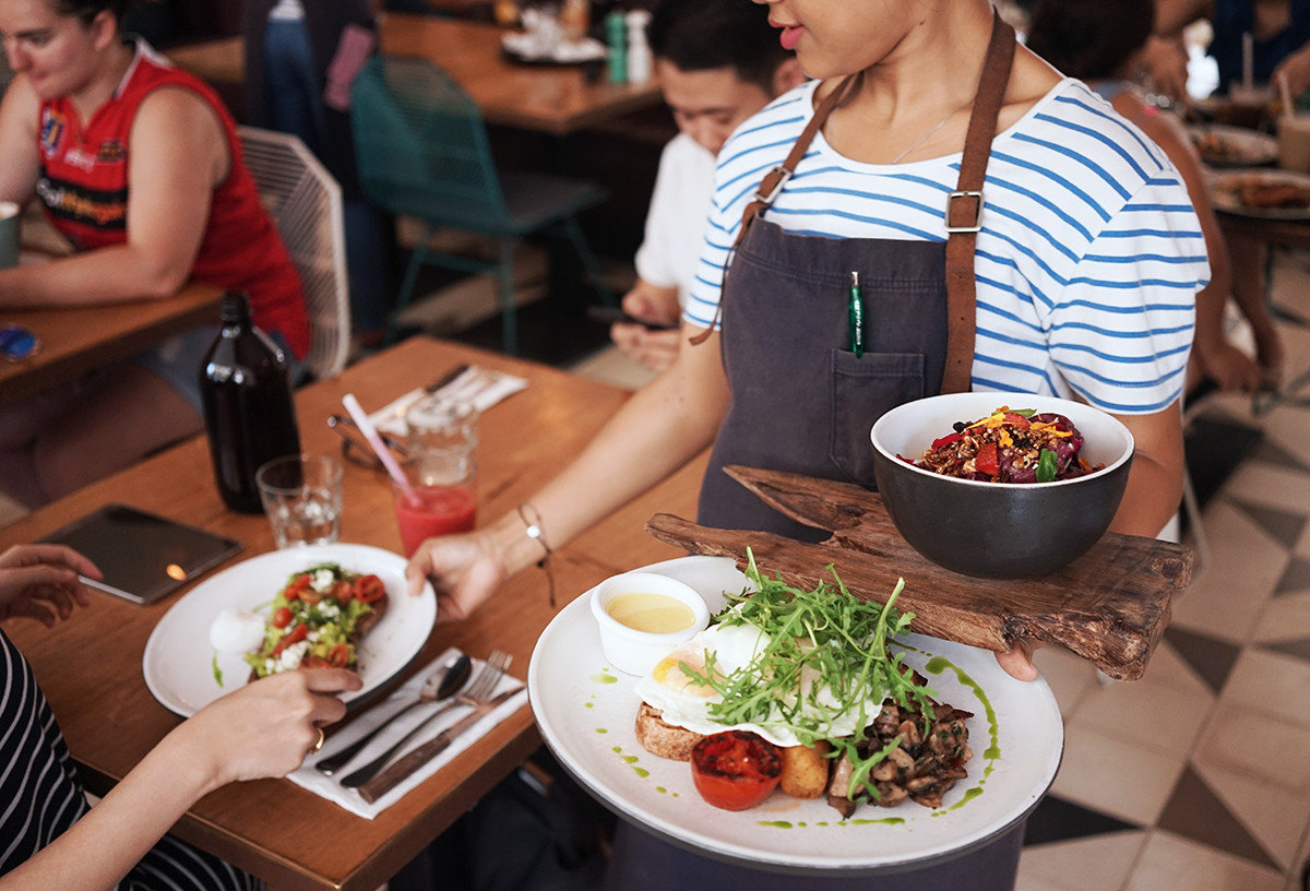 Food + Drink person table meal food dish cuisine plate brunch lunch supper dinner asian food breakfast people eating dining table