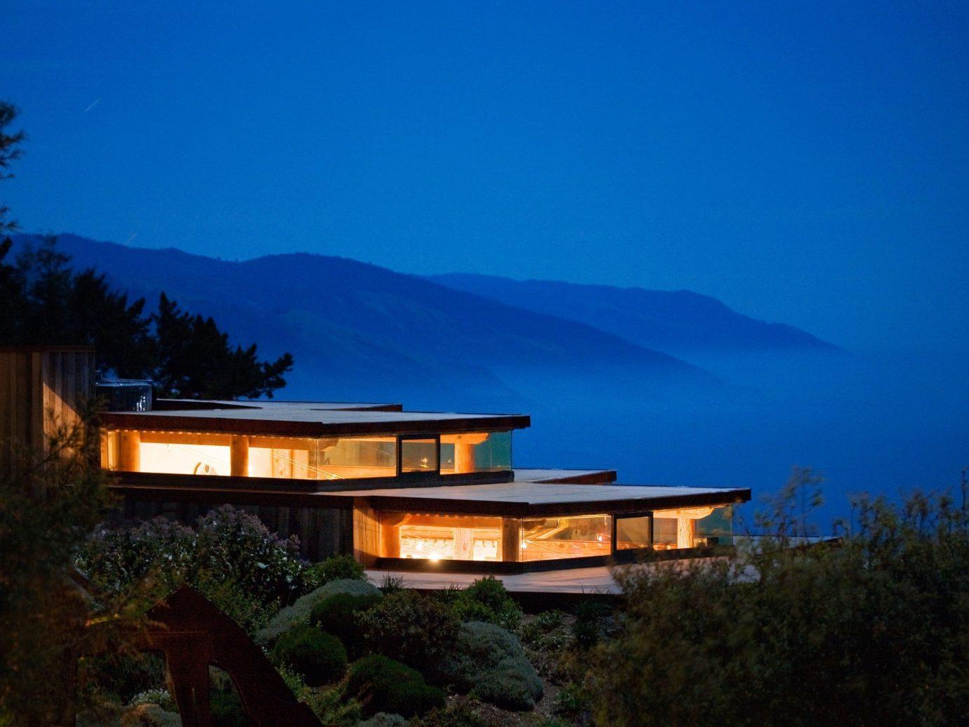 Hotels Trip Ideas tree outdoor sky house night mountain reflection evening morning estate dusk sign hillside