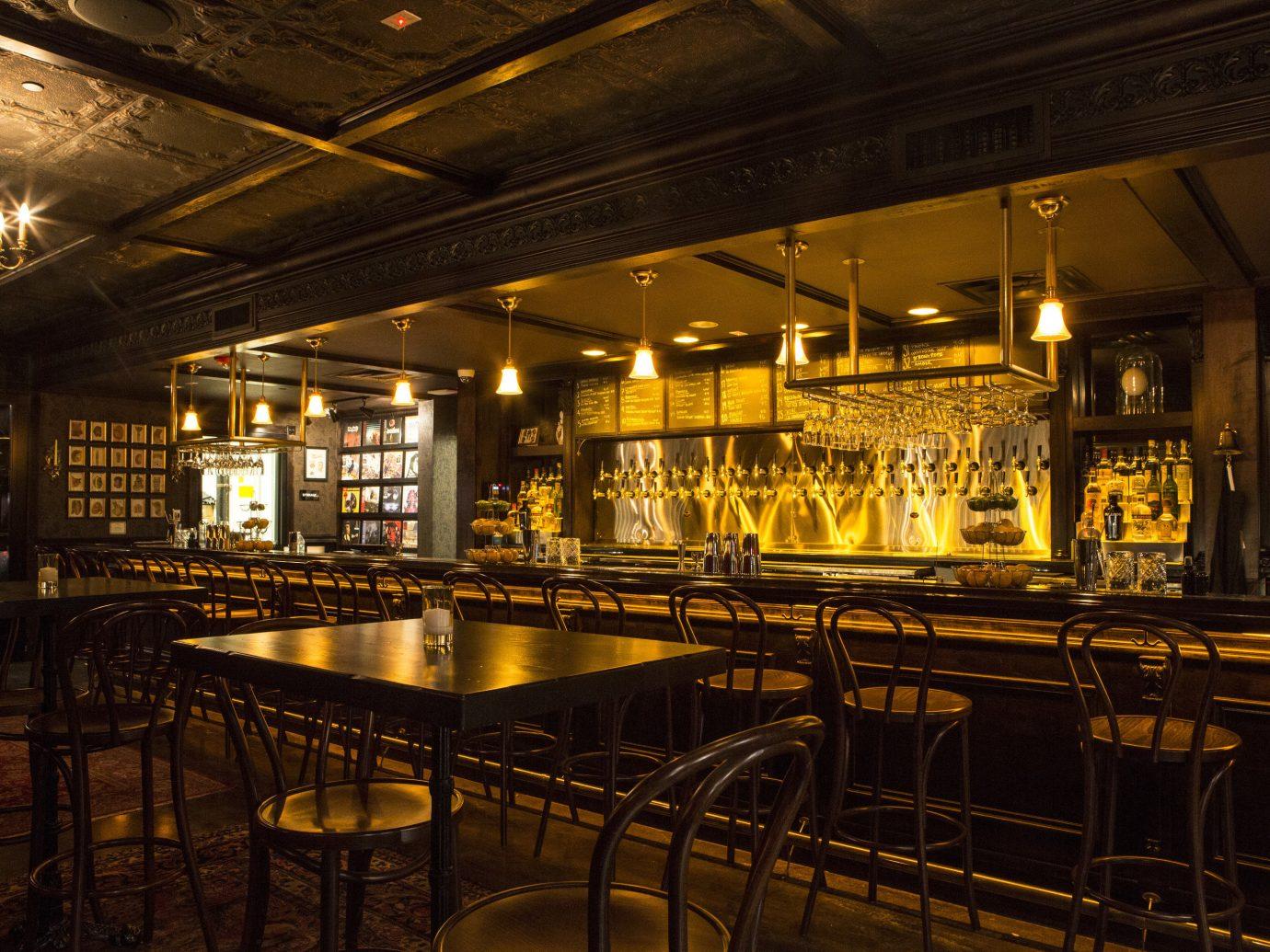 Arts + Culture ceiling indoor building Bar night restaurant metal lighting interior design estate several dining room