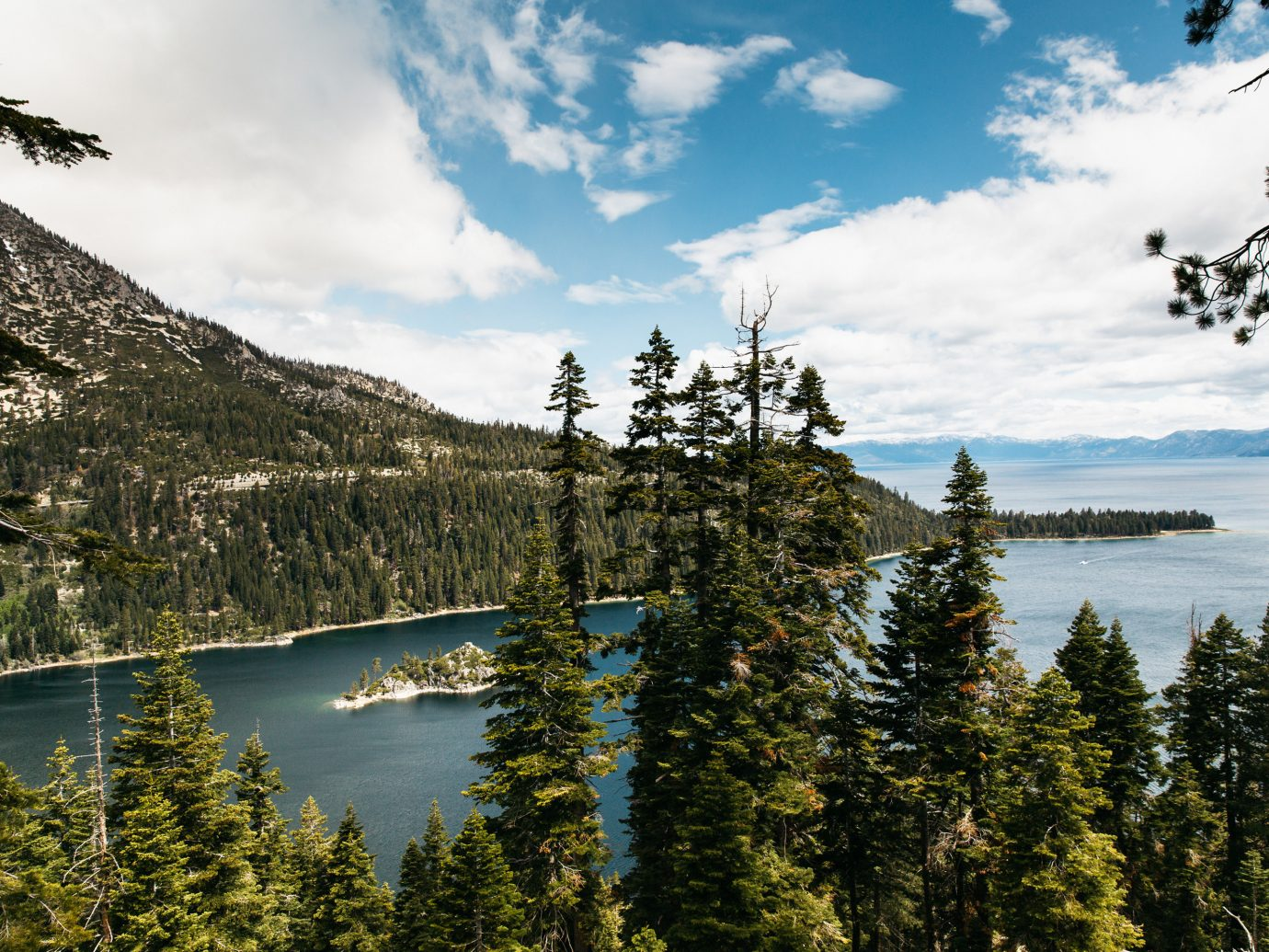 Hotels Style + Design Trip Ideas tree outdoor sky Nature wilderness Lake water reflection mountain cloud mount scenery pond national park biome terrain landscape conifer crater lake pine family reservoir mountain range plant Forest elevation pine wooded hillside surrounded