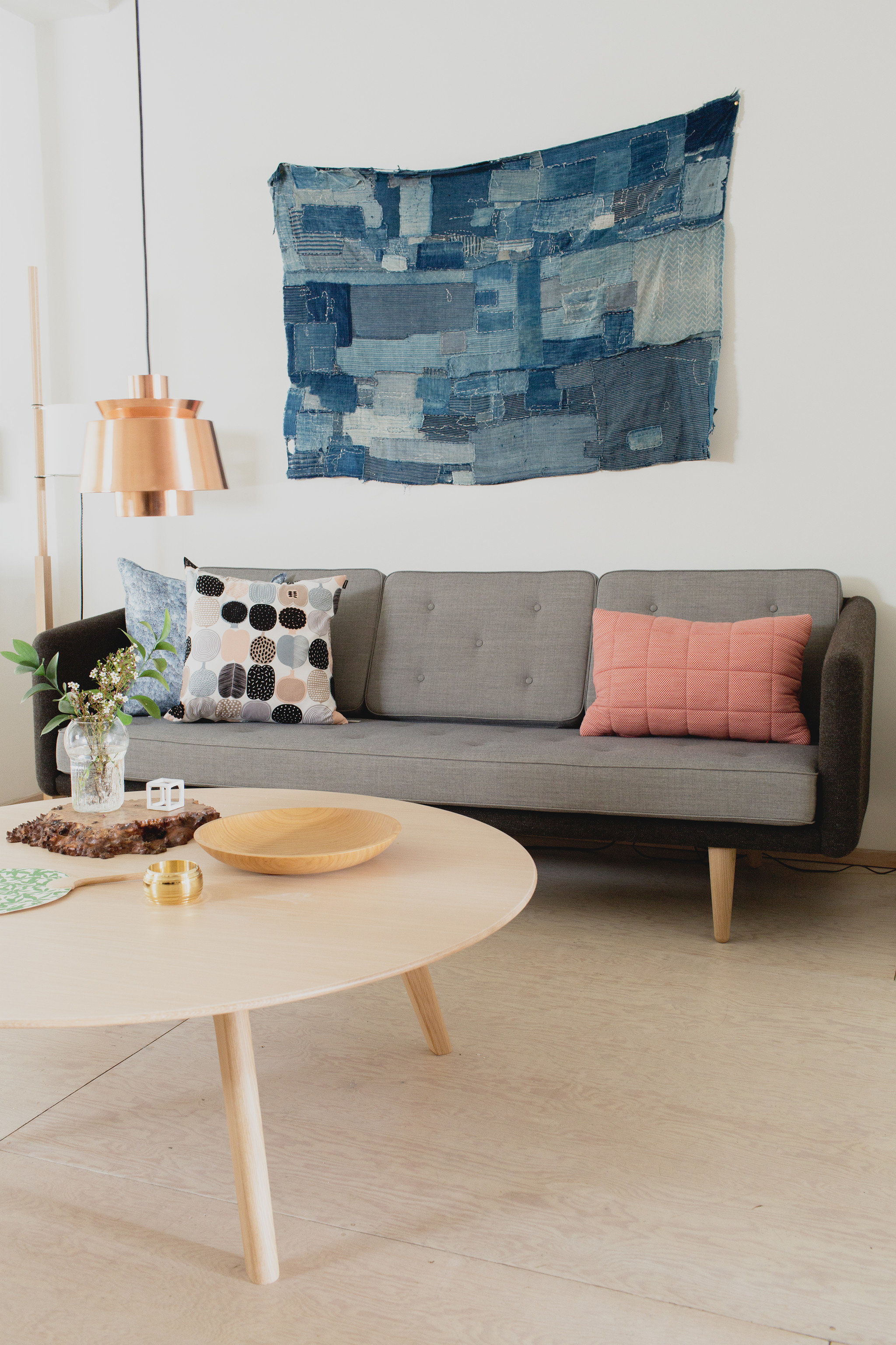 Trip Ideas wall Living indoor floor sofa room furniture living room table seat couch wood interior design bed sheet Design studio couch decorated area tan