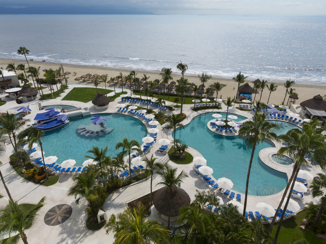 All-Inclusive Resorts Hotels outdoor sky water Resort swimming pool leisure resort town Nature vacation tourism palm tree arecales tropics Sea aerial photography tree bay Lagoon recreation shore