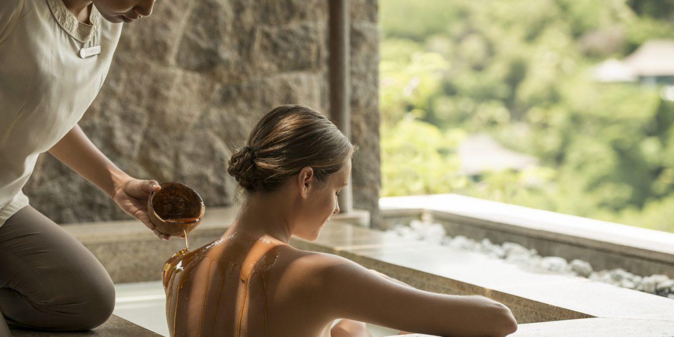 Health + Wellness Spa Retreats Travel Tips person tree outdoor photograph human positions woman photography Beauty sitting leg photo shoot Romance