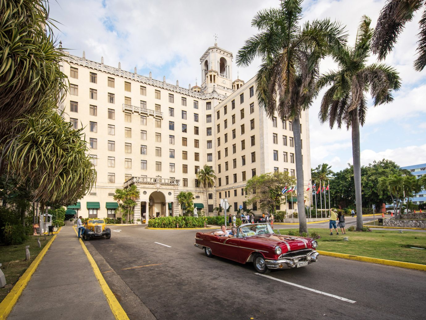 Hotels Luxury Travel car land vehicle plant woody plant tree sky palm tree arecales urban area City infrastructure metropolitan area vehicle road Architecture building street neighbourhood residential area Downtown daytime luxury vehicle plaza house real estate metropolis condominium facade compact car sedan mid size car