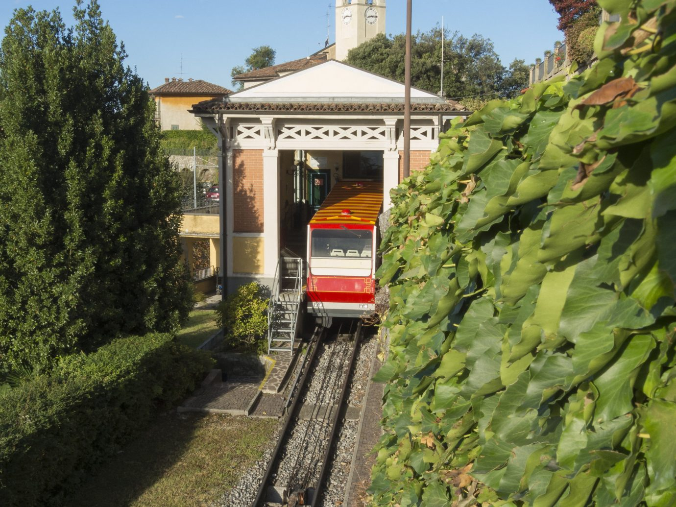Arts + Culture Italy Milan Trip Ideas transport vehicle rolling stock rail transport track tree train plant sky