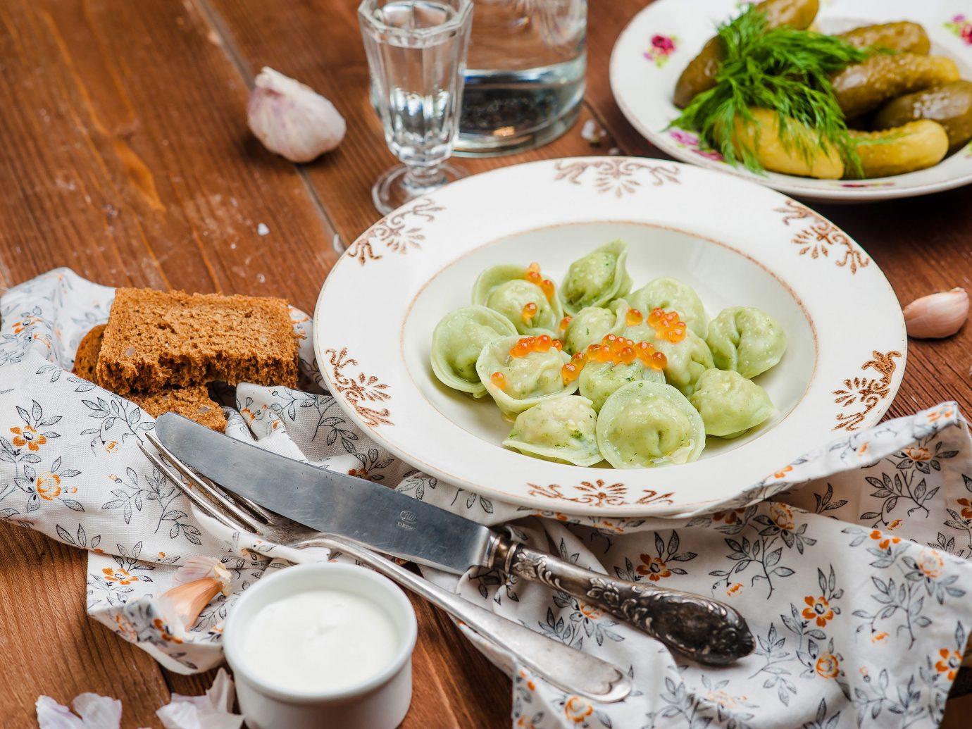 Arts + Culture Hotels Jetsetter Guides table plate food dish meal cuisine wooden vegetarian food breakfast brunch vegetable tableware recipe several