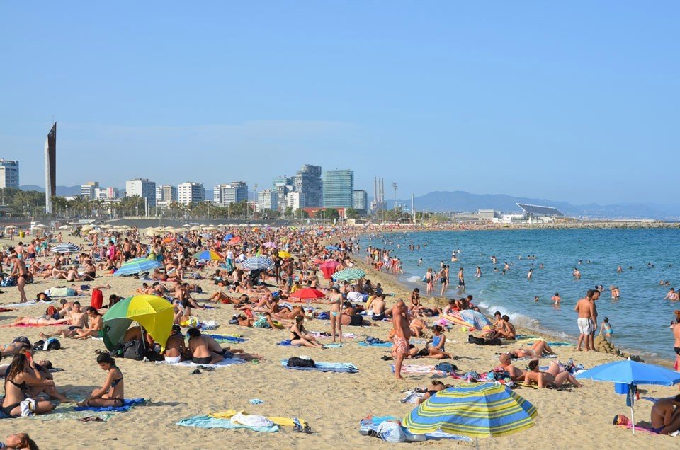 Trip Ideas outdoor sky Beach ground people body of water Sea enjoying group shore swimming day crowd several