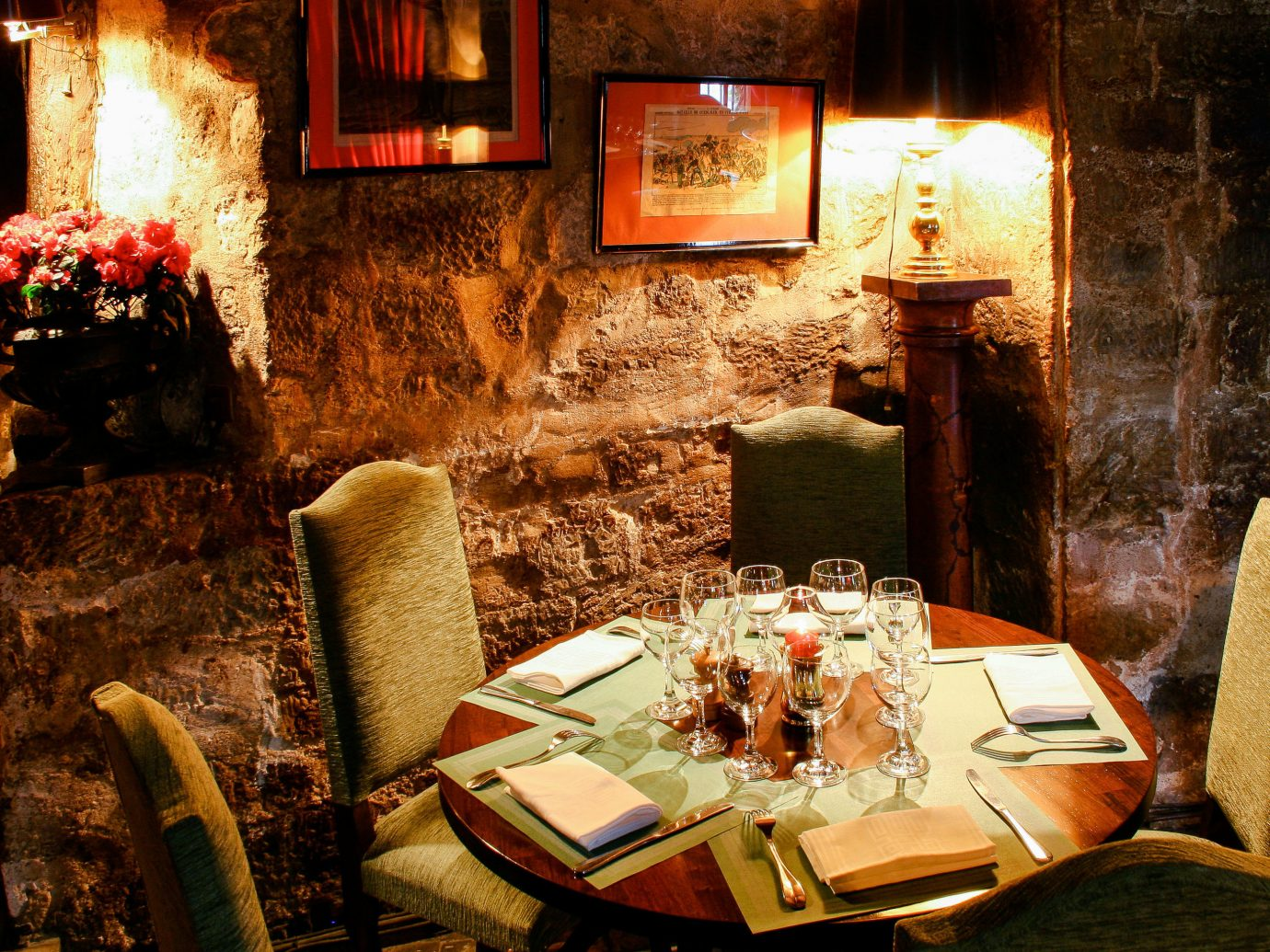 Food + Drink Romance indoor Living restaurant Fireplace table interior design old slice decorated furniture dining table