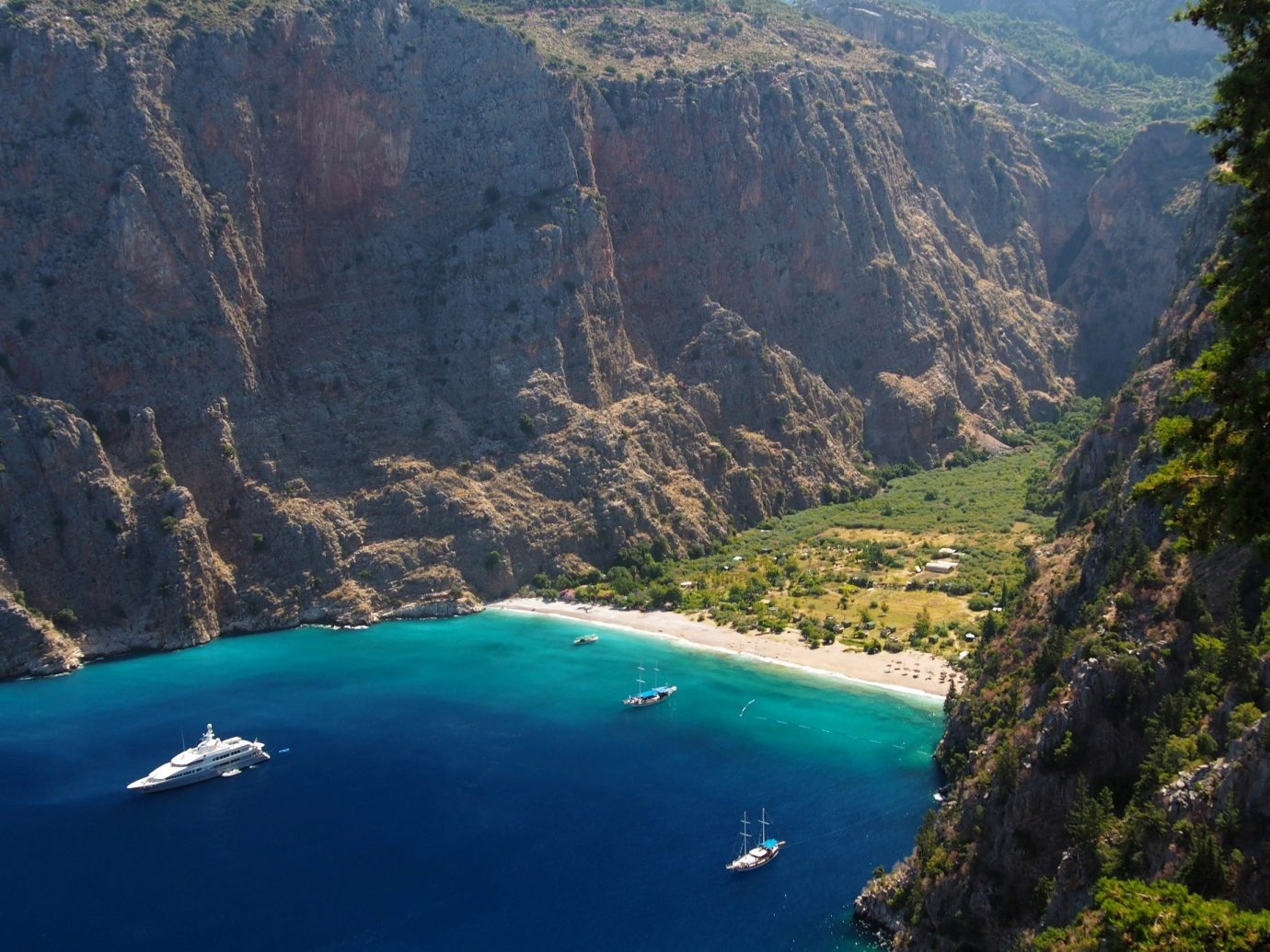 Beach Secret Getaways mountain Nature outdoor valley landform geographical feature canyon body of water fjord Lake Coast mountain range Sea bay cliff terrain crater lake reservoir hillside surrounded