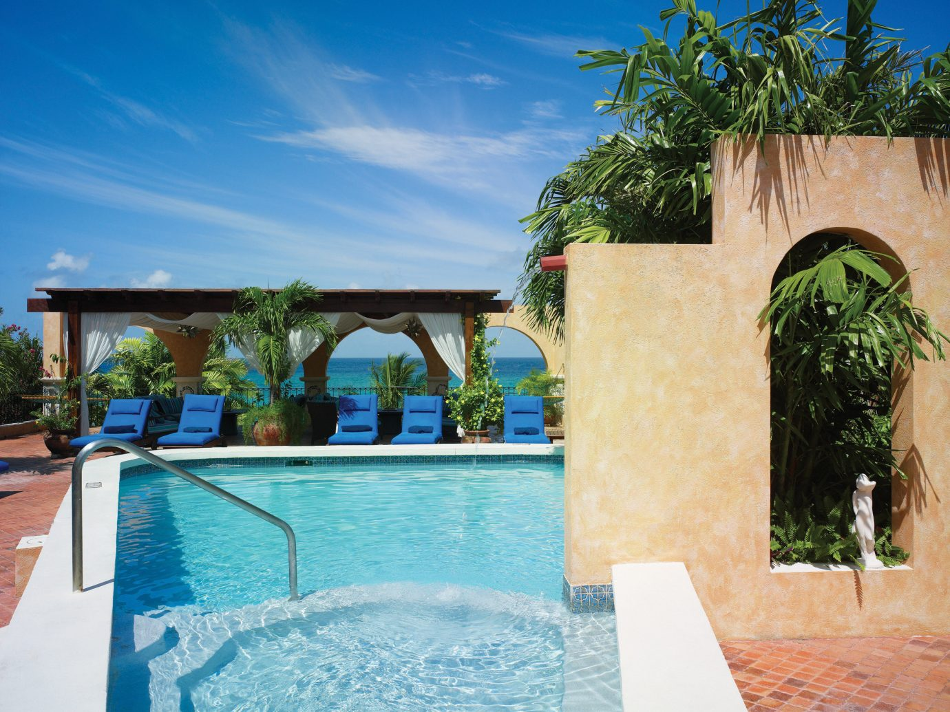 Hotels outdoor swimming pool property leisure building estate Pool vacation Resort Villa house home hacienda backyard real estate mansion blue stone