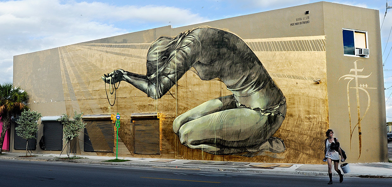 art Arts + Culture brick wall City city streets city views graffiti people street art urban sky outdoor mural urban area road wall street sculpture monument statue