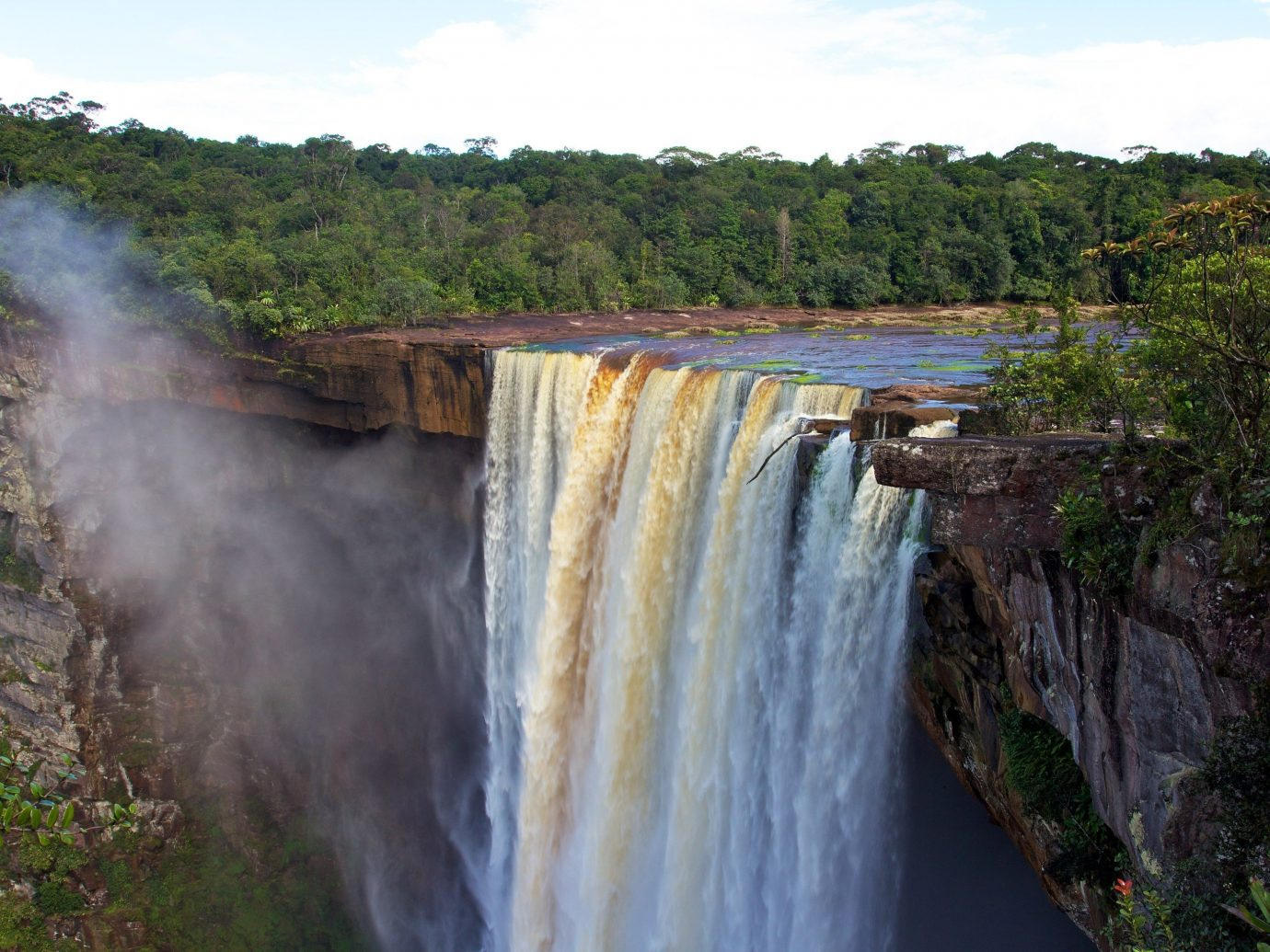 Health + Wellness Trip Ideas train outdoor tree Nature sky Waterfall track body of water water water feature watercourse River wasserfall reservoir cliff terrain Forest traveling wood