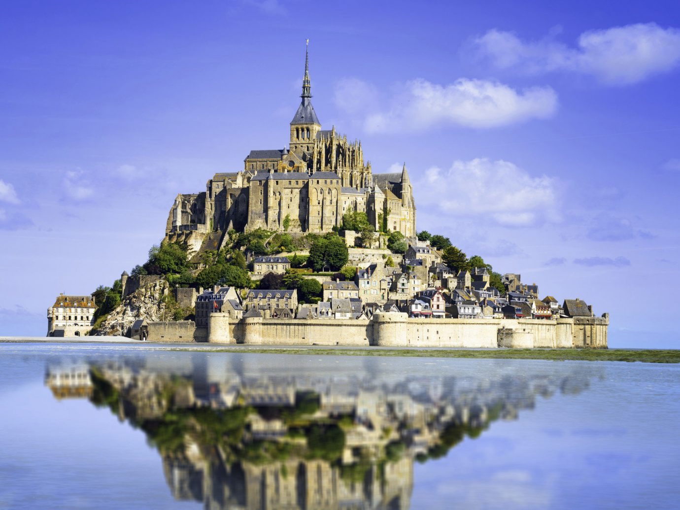 Trip Ideas sky outdoor water reflection building landmark place of worship tourism temple castle Sea cityscape château monastery stone day