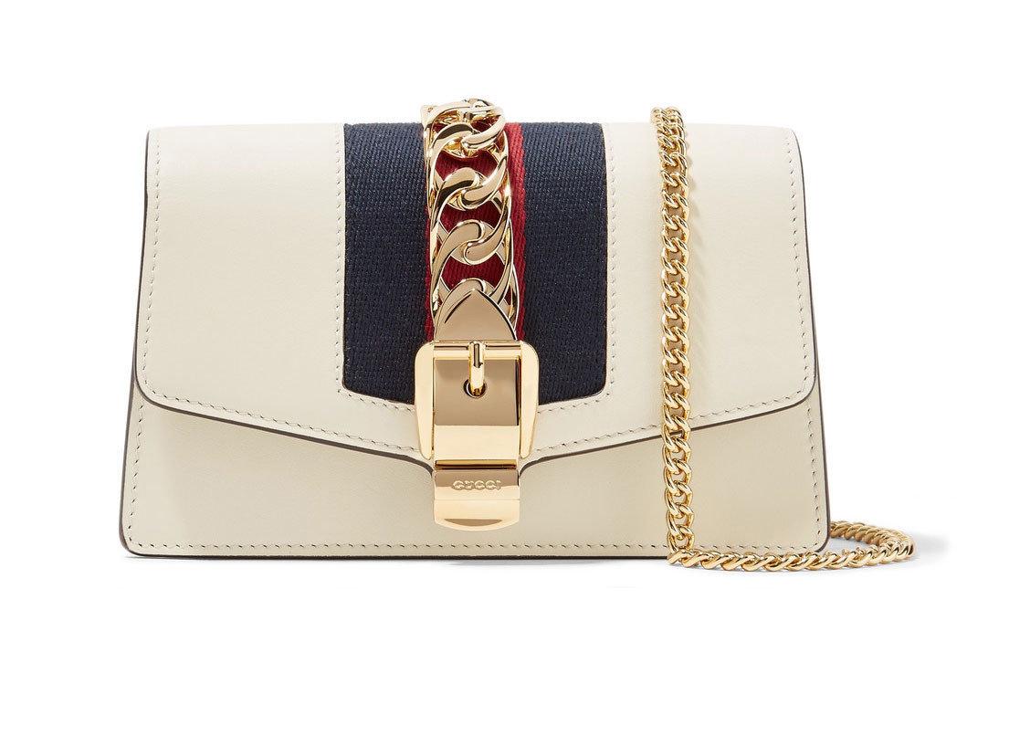 Travel Shop Travel Trends bag handbag indoor shoulder bag accessory case fashion accessory beige chain product brand leather strap rectangle