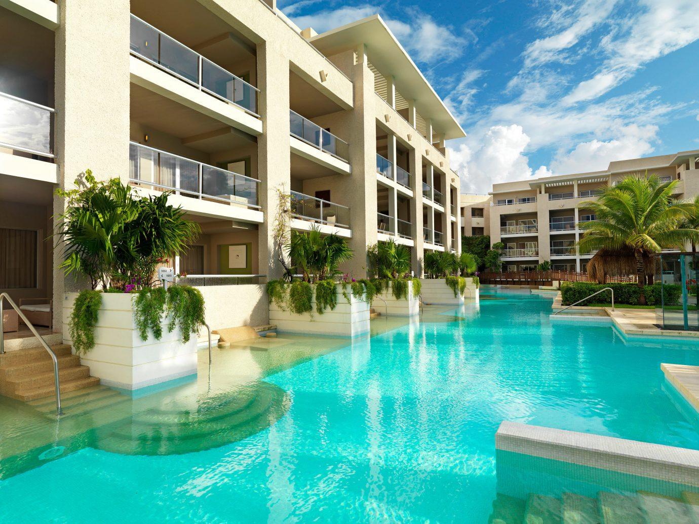 Hotels building condominium swimming pool Resort property leisure Pool estate leisure centre real estate home blue resort town Villa apartment mansion swimming