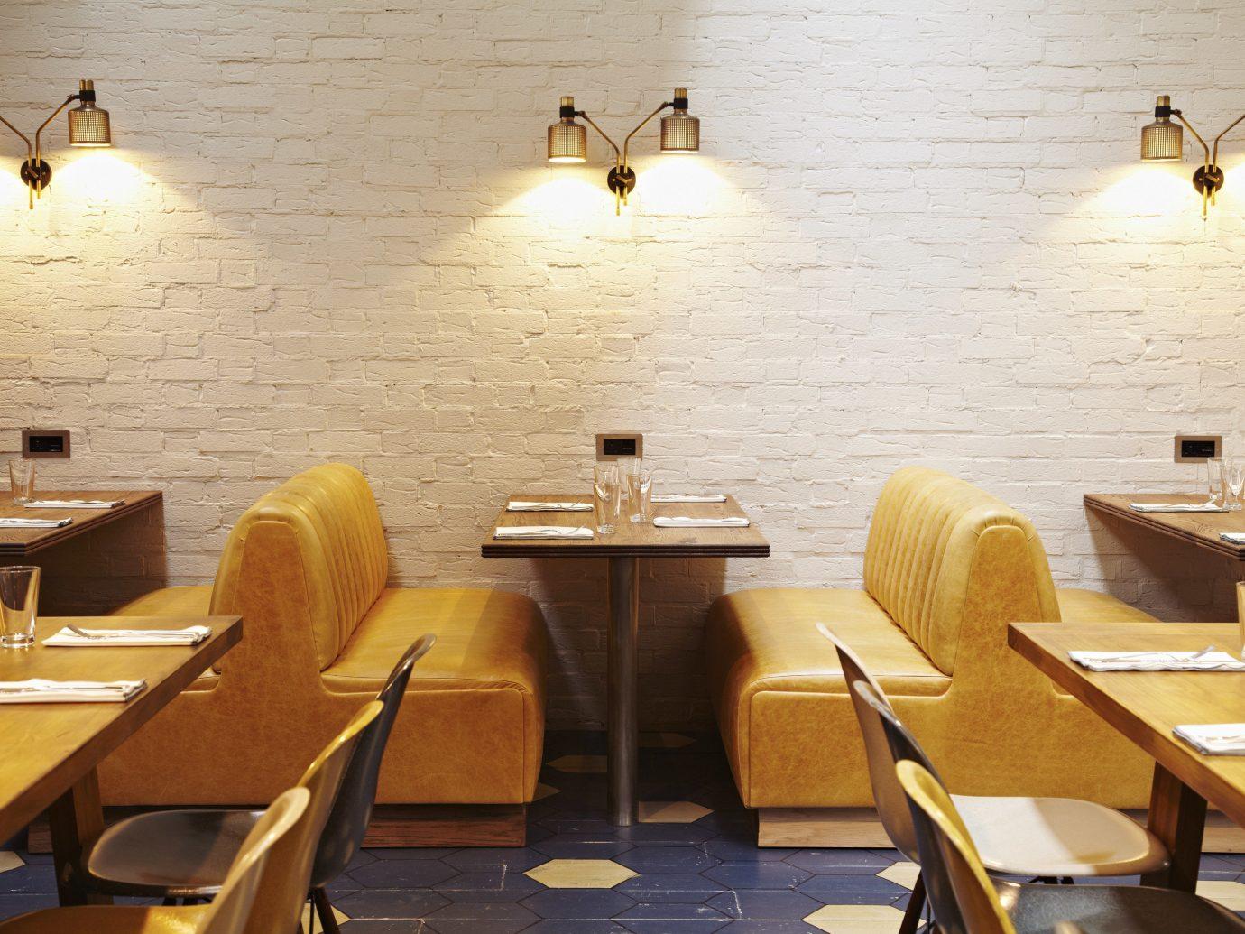 Budget Hotels London table room restaurant dining room wooden lighting interior design wood furniture
