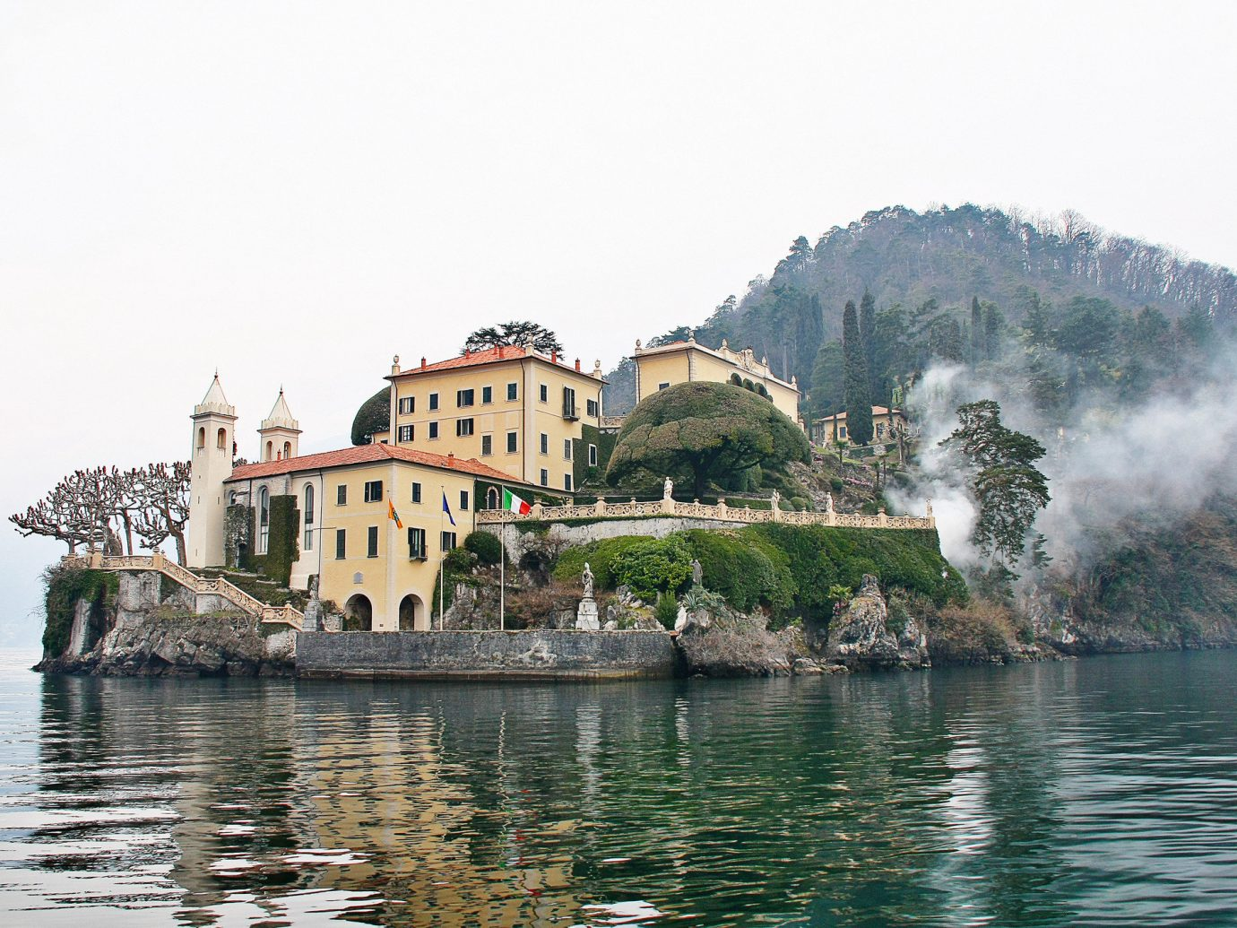 Trip Ideas outdoor water sky Boat promontory Lake tourist attraction Sea building tree mountain palace Coast tourism City bay