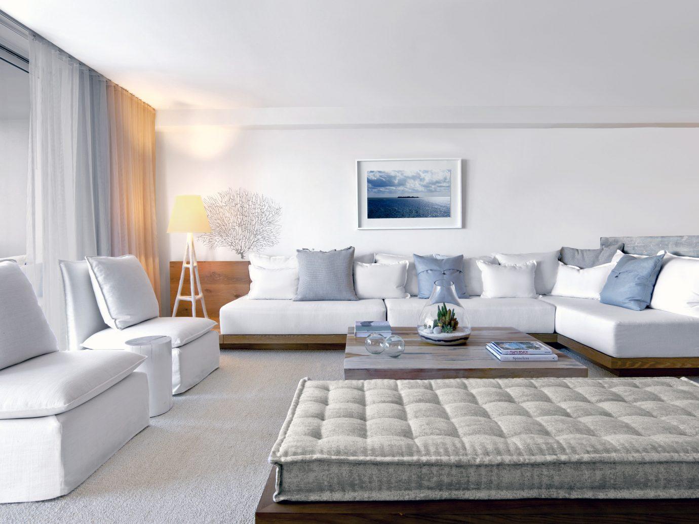 Beach Hotels Romance indoor sofa floor wall Living room property living room Suite interior design furniture white real estate home Bedroom Design condominium apartment estate