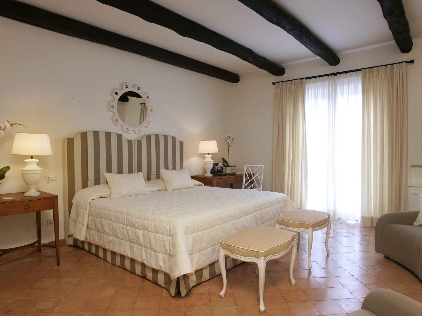 Hotels Luxury Travel floor indoor wall bed room Bedroom property Suite hotel interior design ceiling estate cottage real estate Villa wood furniture