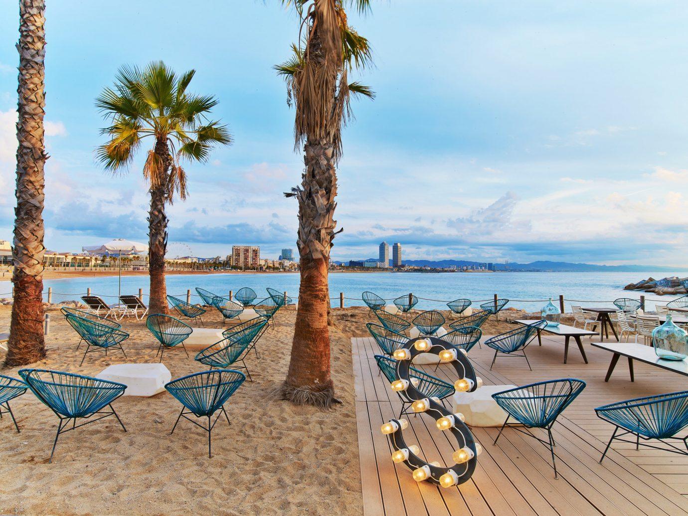 Hotels sky tree outdoor Beach water body of water Sea vacation shore Ocean Resort Coast estate bay sandy