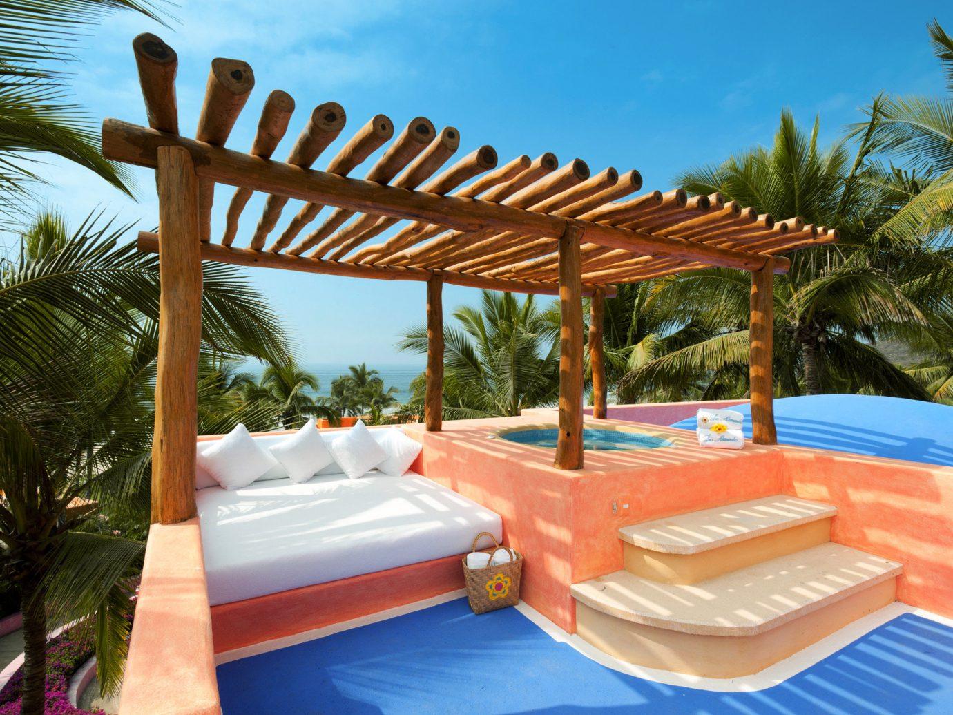 Beachfront Hot tub Hot tub/Jacuzzi Hotels Luxury Romance tree outdoor swimming pool property leisure Resort Villa vacation estate eco hotel outdoor structure hacienda caribbean
