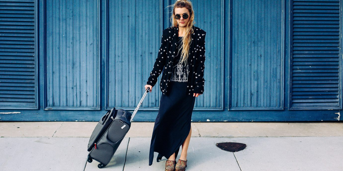 Hotels Packing Tips Travel Tips Trip Ideas building outdoor blue denim cellphone person jeans phone fashion sidewalk road girl outerwear socialite jacket electric blue pattern trousers Winter street