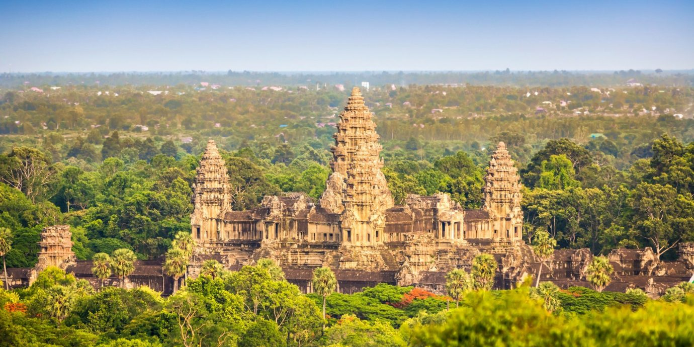 Jetsetter Guides tree outdoor grass historic site landmark building pagoda tourism temple place of worship tower castle wat unesco world heritage site hillside lush