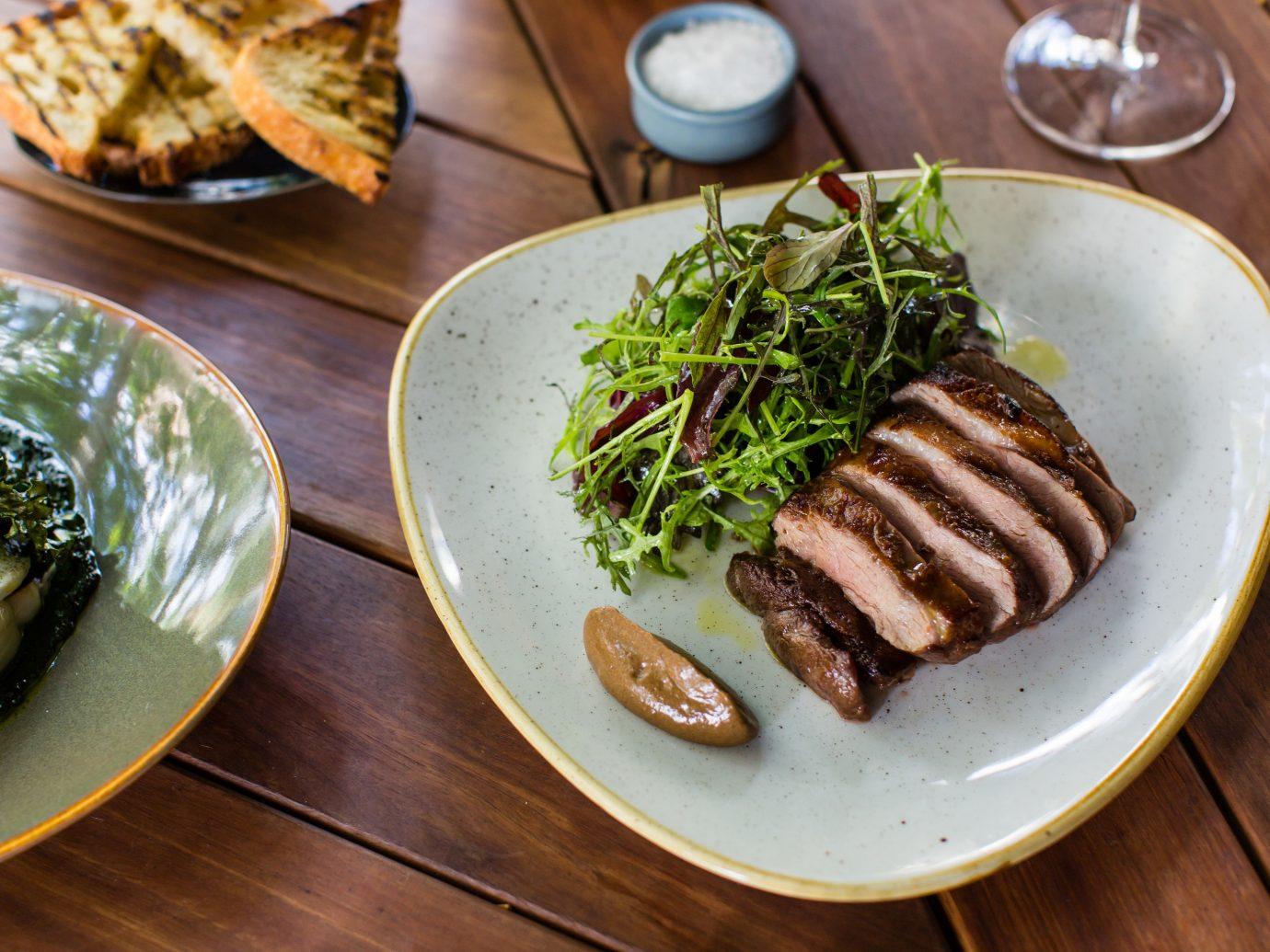 Trip Ideas plate table food dish meat wooden meal restaurant steak produce cuisine dinner several vegetable piece de resistance