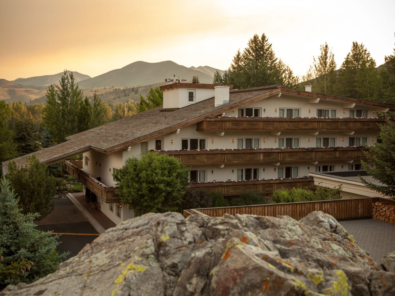 Fall Travel Mountains + Skiing National Parks Outdoors + Adventure Trip Ideas tree sky outdoor rock house mountainous landforms mountain property home Architecture real estate roof estate plant building Village landscape mountain range stone hill facade Villa elevation mountain village hillside