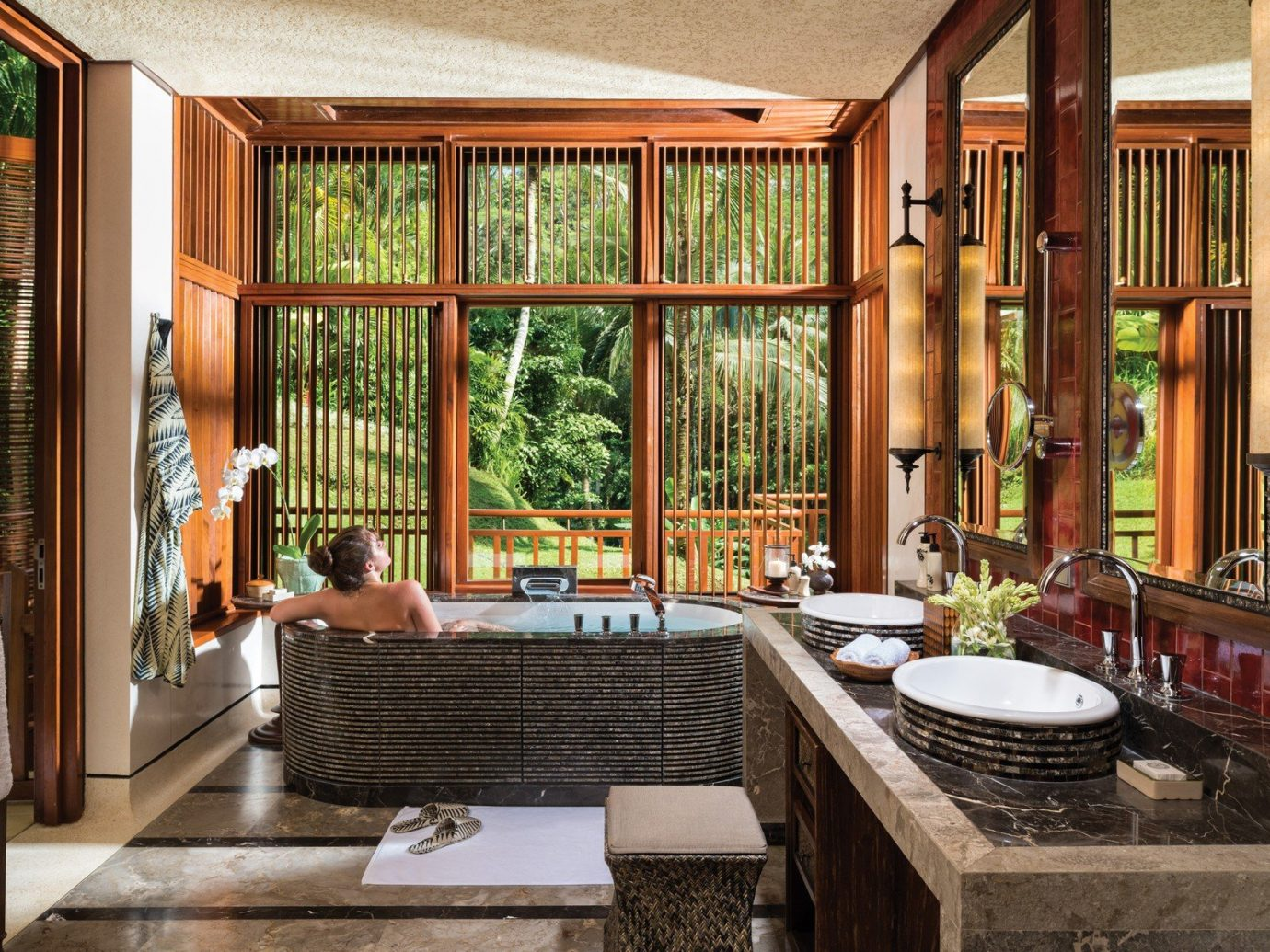 Bath bathroom calm Elegant Garden view Greenery Health + Wellness Hotels isolation Luxury open-air people regal relaxation relaxing remote Rustic serene sophisticated Tropical view woman room property indoor window estate porch home interior design living room wood cottage real estate Design farmhouse mansion stone tub furniture